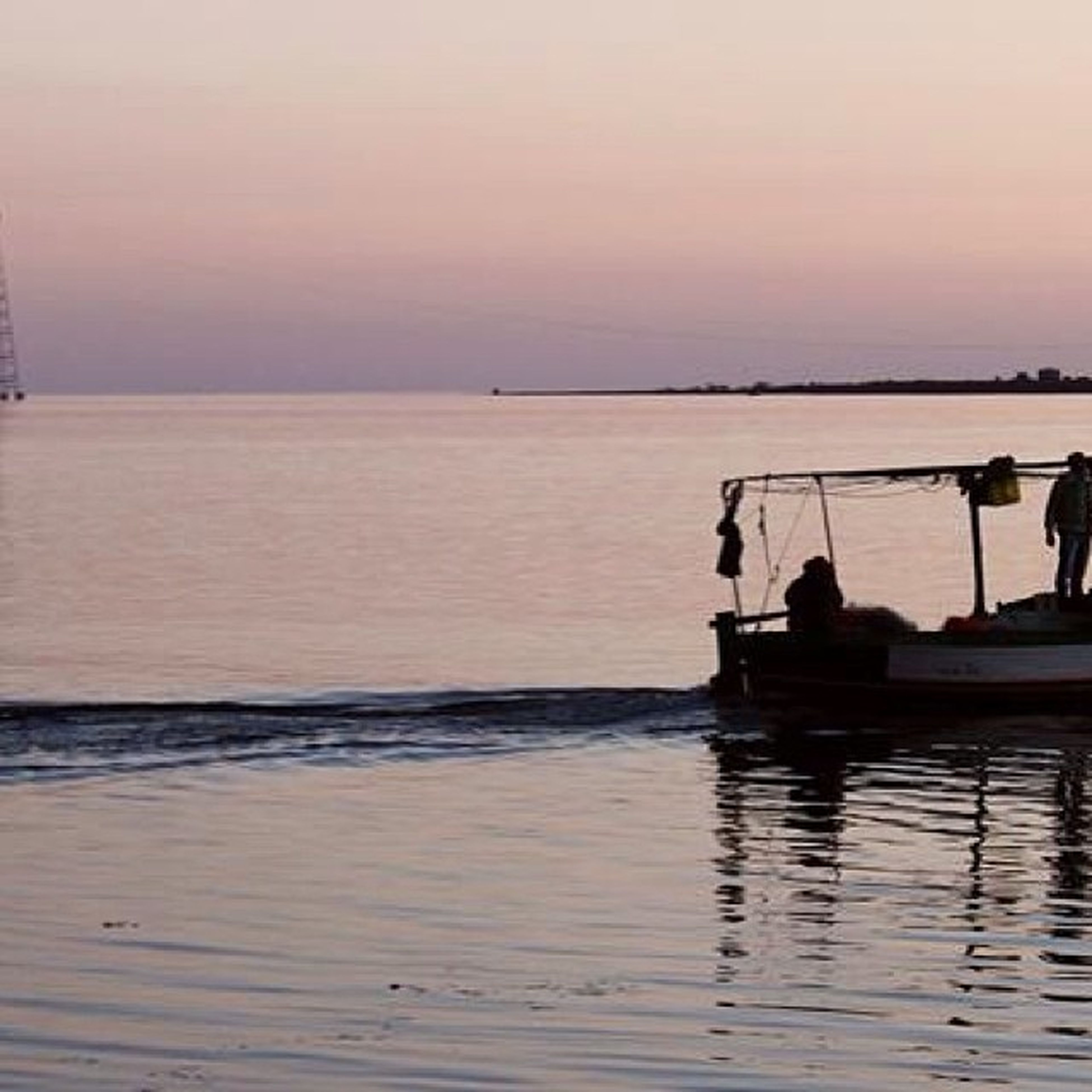 water, sunset, nautical vessel, transportation, sea, boat, silhouette, mode of transport, tranquil scene, horizon over water, tranquility, scenics, reflection, beauty in nature, men, waterfront, sky, nature, idyllic