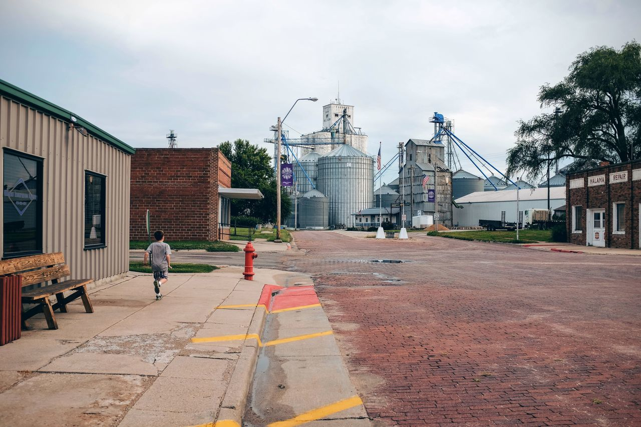 Photo essay, a day in the life. August 24, 2016 Milligan Nebraska 35mm Camera A Day In The Life Brick Road Camera Work City Street Diminishing Perspective Everyday Lives Eye For Photography EyeEm Best Shots EyeEm Gallery Eyeemphoto FujiX100S Grain Elevator Grain Silos Main Street USA Outdoors Photo Essay Rural America Small Town America Small Town Stories Storytelling Street Streetphotography The Way Forward Town