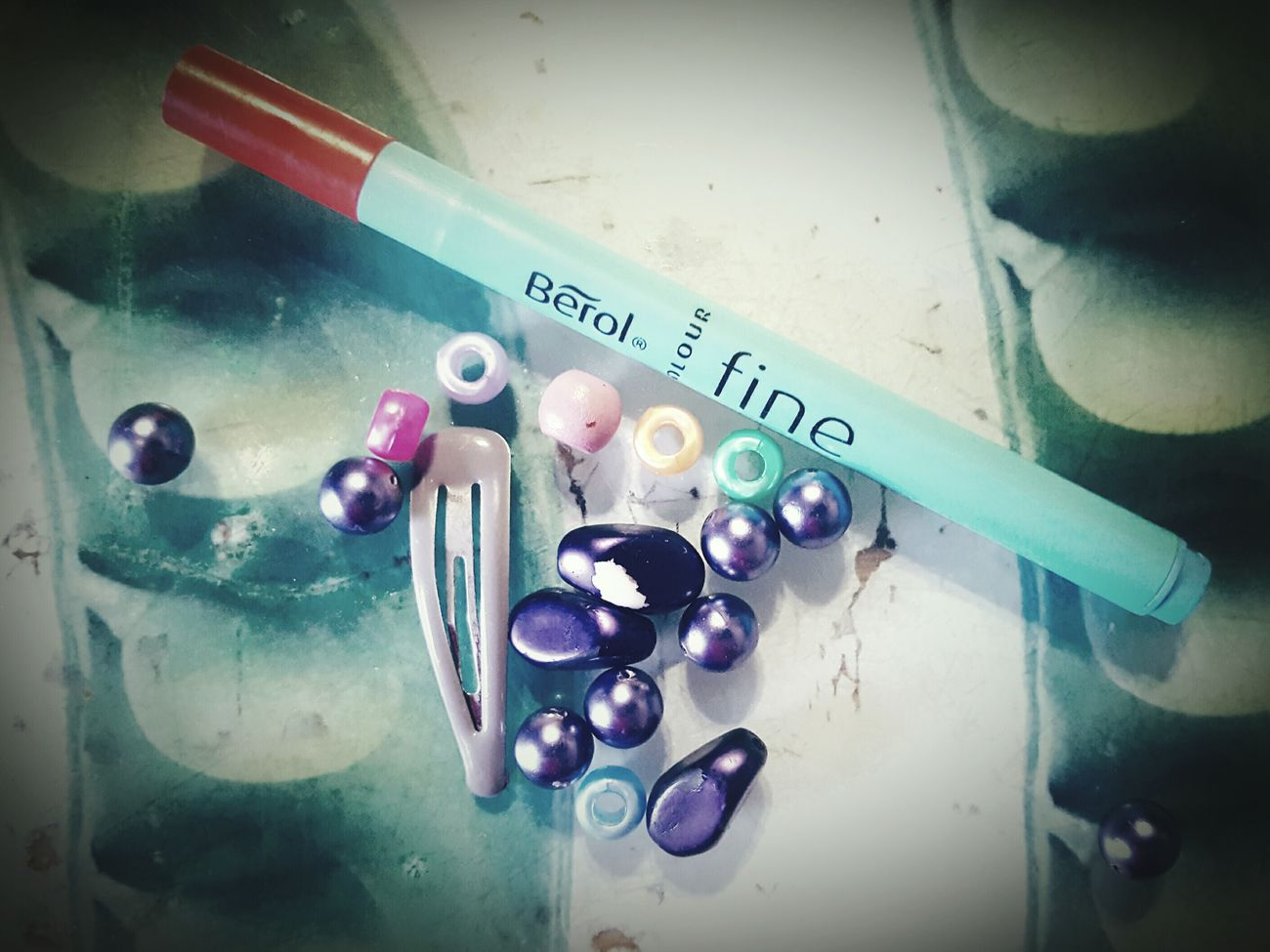 Before Ten The Kitchen Table Random Objects Collection Hairclip Beads Pen