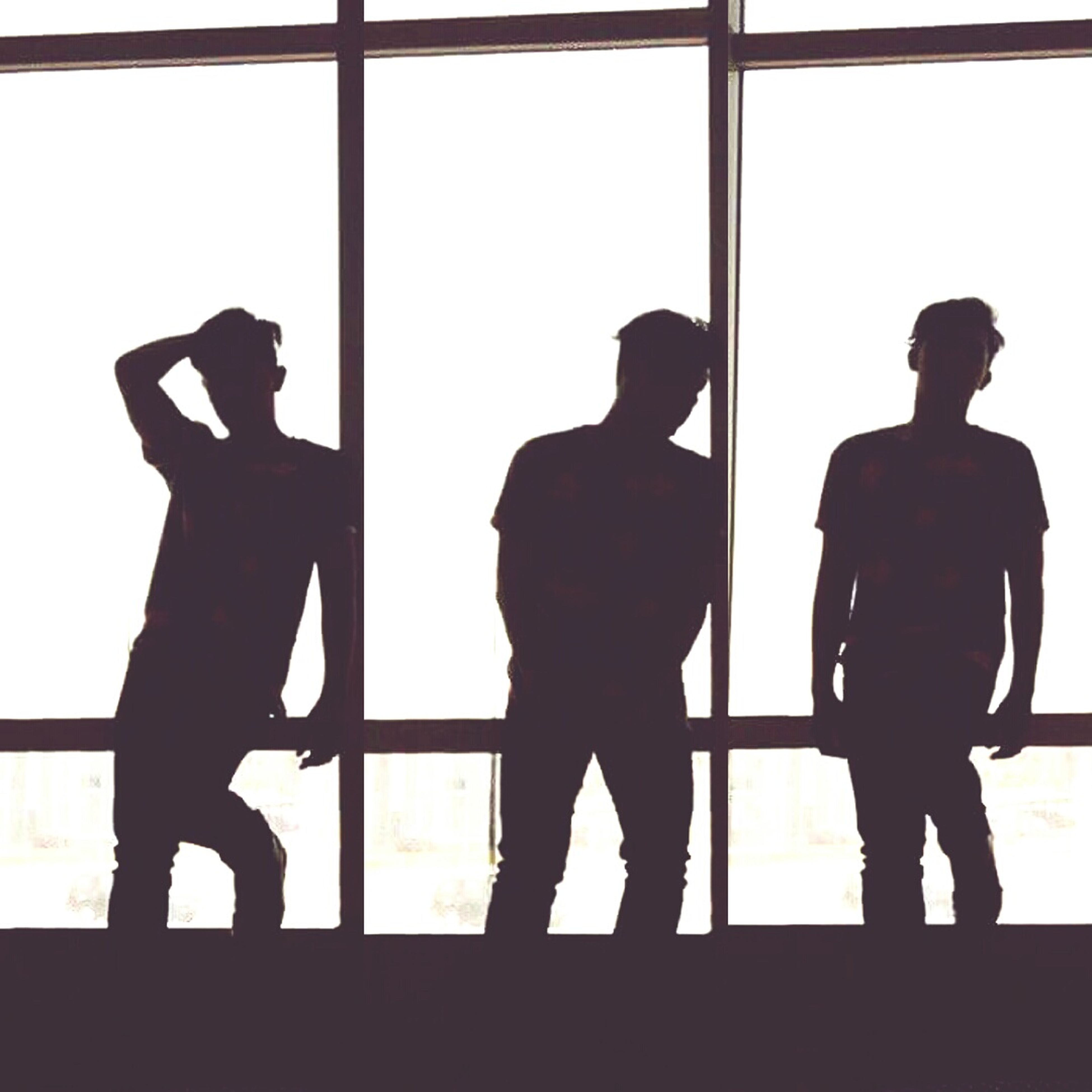 silhouette, indoors, window, standing, men, full length, glass - material, human representation, togetherness, day, outline, transparent, clear sky, lifestyles, love, door, copy space