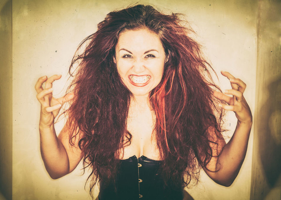 Corset Dangerous Emotion Female Grimace Intense Long Hair Madness One Person One Woman Only Person Portrait Rage Teased Hair Tooth Toothy Smile Wild Hair Woman Young Adult