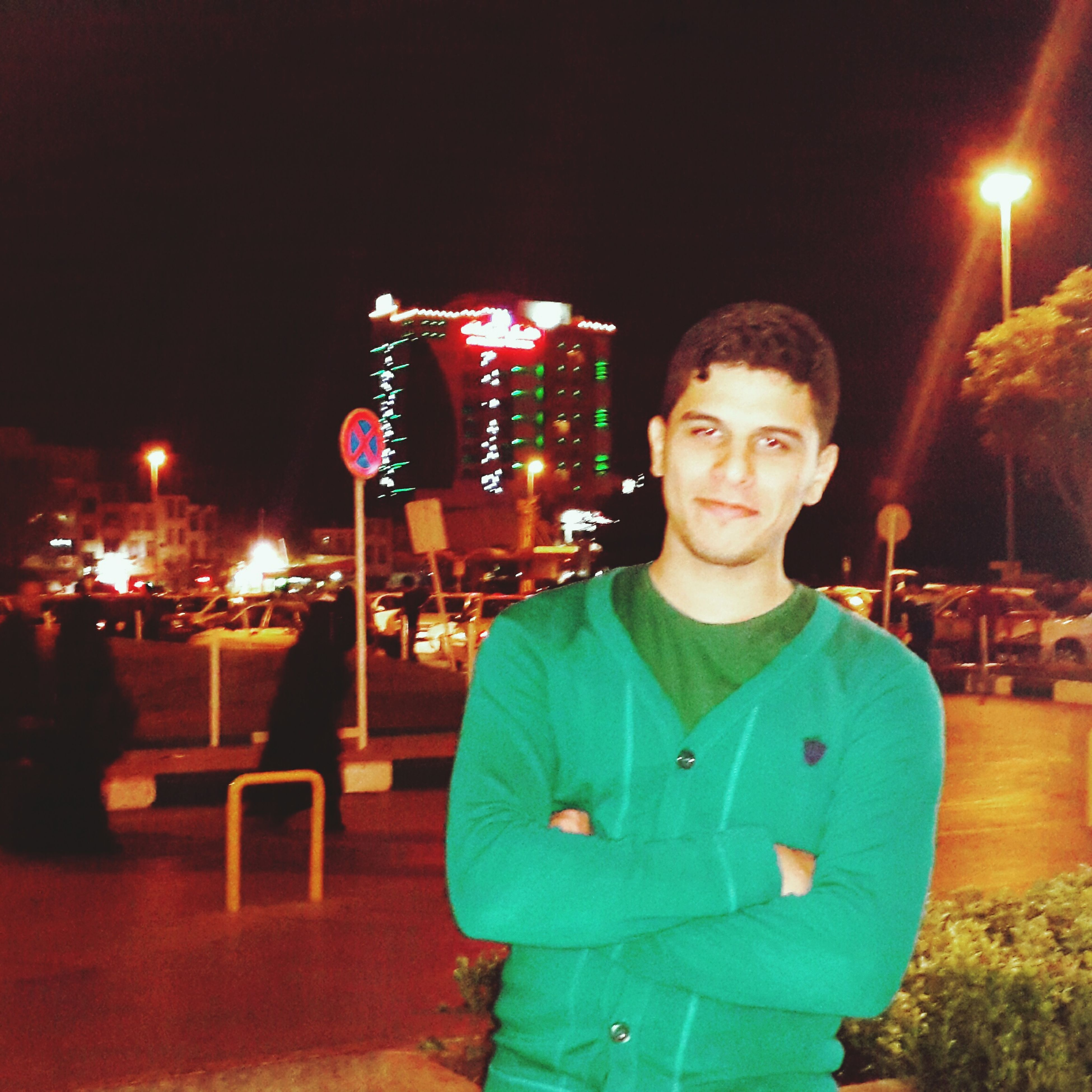 illuminated, night, lifestyles, leisure activity, casual clothing, lighting equipment, standing, front view, celebration, sitting, waist up, arts culture and entertainment, looking at camera, portrait, three quarter length, person, incidental people, holding