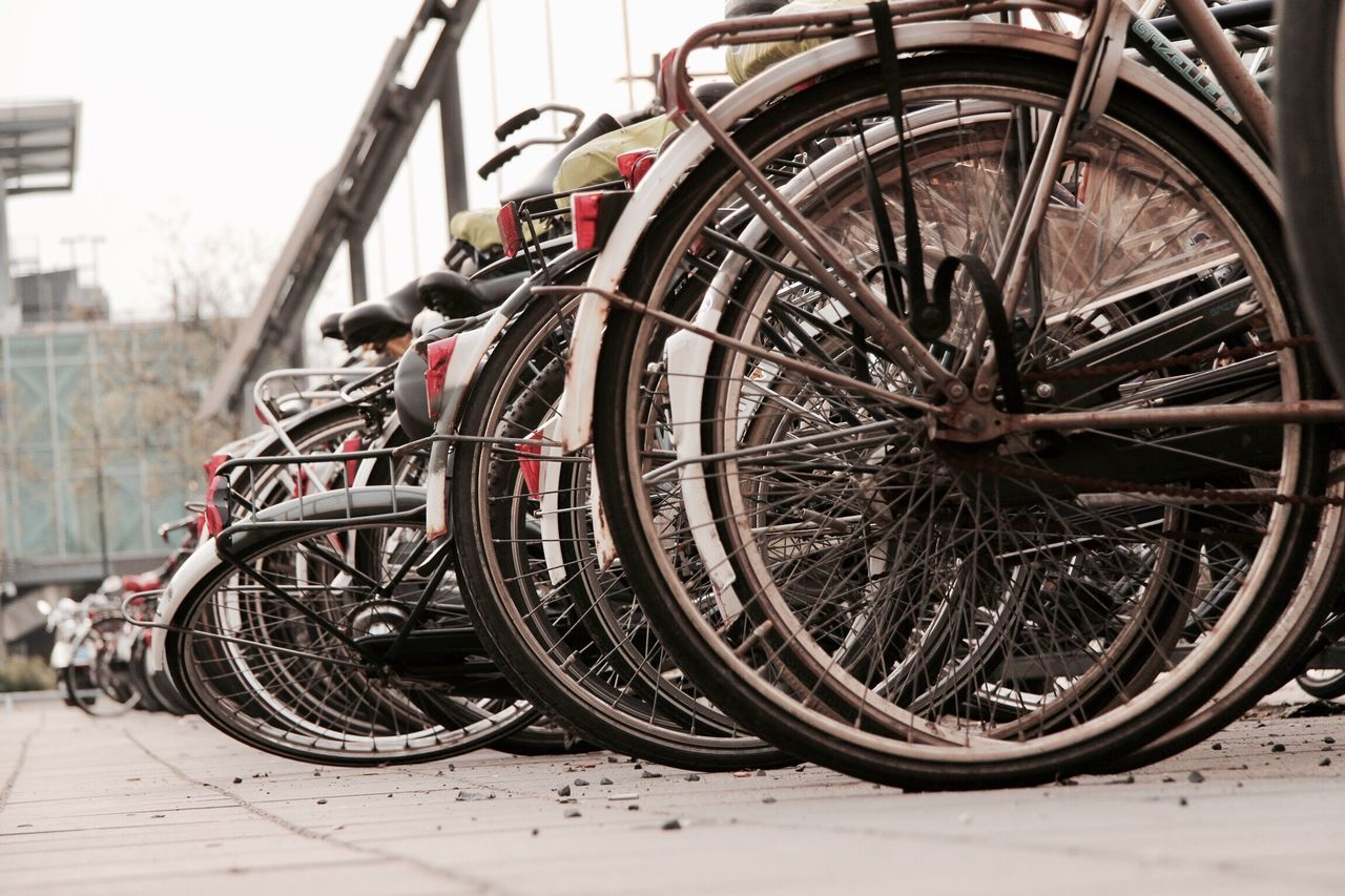 Bicycle Mode Of Transport Wheel Parking Stationary Close-up Focus On Foreground Parked Spoke No People City Life Dense Lots Of Bikes Fallen Bike The Netherlands Bike Country Parked At Station Old Bikes