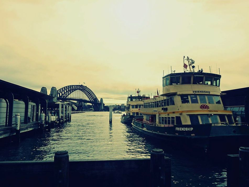 Architecture Sky Water Built Structure Sunset Sea Outdoors Bridge - Man Made Structure No People Harbor Day Sydney, Australia Sydney Harbour Bridge EyeEmNewHere Australia Australia Streetphotography Travel Photography Travel Destinations Travelling Travel Boat Friendship Ferryboat Ferry Ferry Terminal