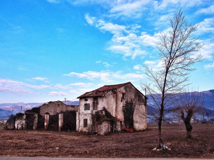 Italy, my land. Abandoned 😔 Italy Architecture Building Exterior Abandoned Rural Scene Bare Tree Field Sky Cloud Outdoors Countryside Landscape Emotion Photography Mountain Beauty In Nature Tranquil Scene Myland