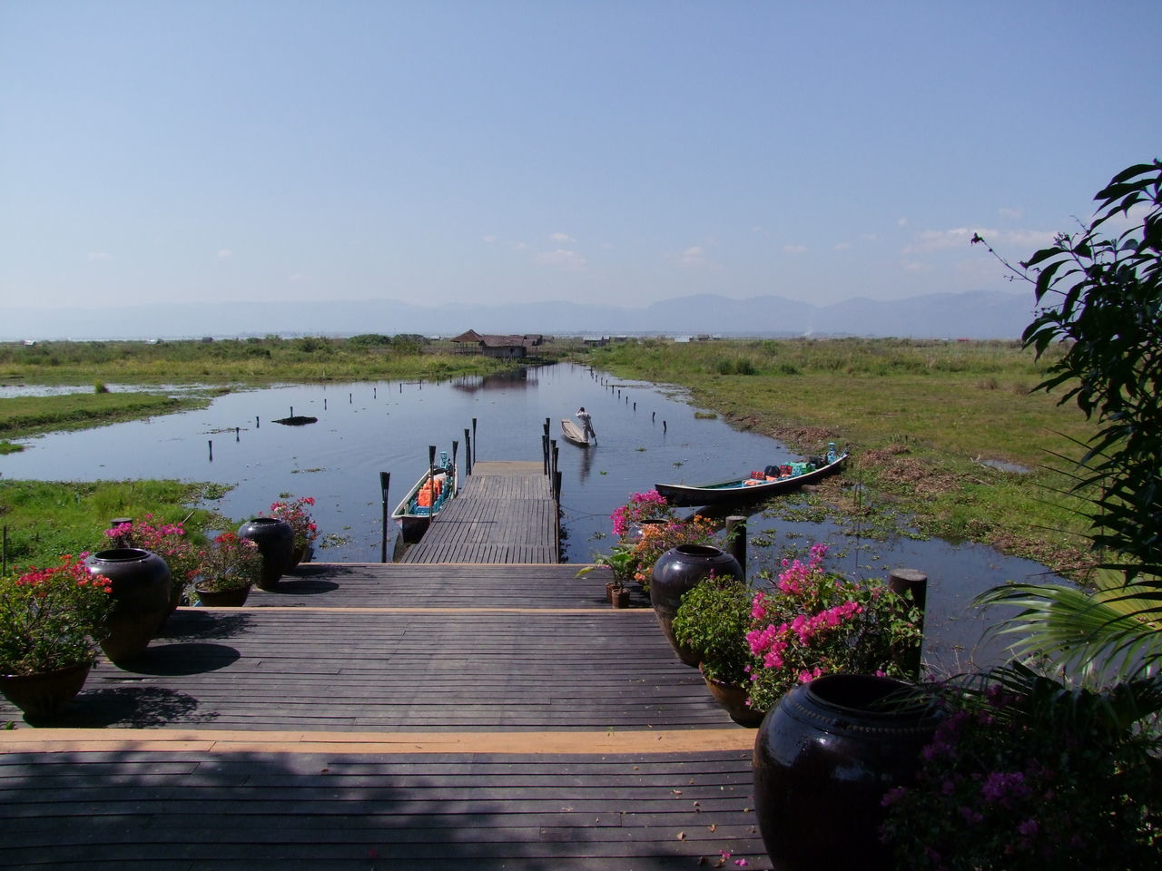 Jetty at Inle Villa Resort Beauty In Nature Blue Sky Composition Floating Vegetable Garden Flowering Shrubs Glassy Water Hotel Inle Lake Jetty Lake Lake View Mode Of Transport Myanmar Narrow Boat Nautical Vessel No People Outdoor Photography Scenics Sunlight And Shadow Tranquil Scene Tranquility Transportation Travel Destination Water Wooden Jetty