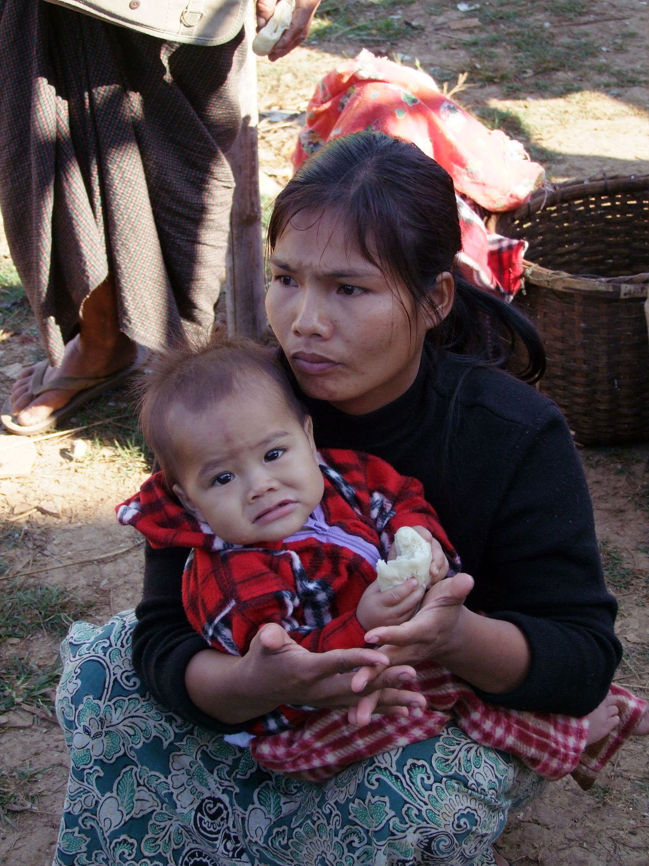 Shan Woman & Child in Market Baby Business Composition Eating Full Frame Inle Lake Making A Living Market Mother Myanmar Offspring Outdoor Photography Portrait Of A Woman Real People Shan State Shan Woman Sunlight And Shade Togetherness Tourism Tourist Attraction  Tourist Destination Traditional Clothing Unhappy Woman And Child