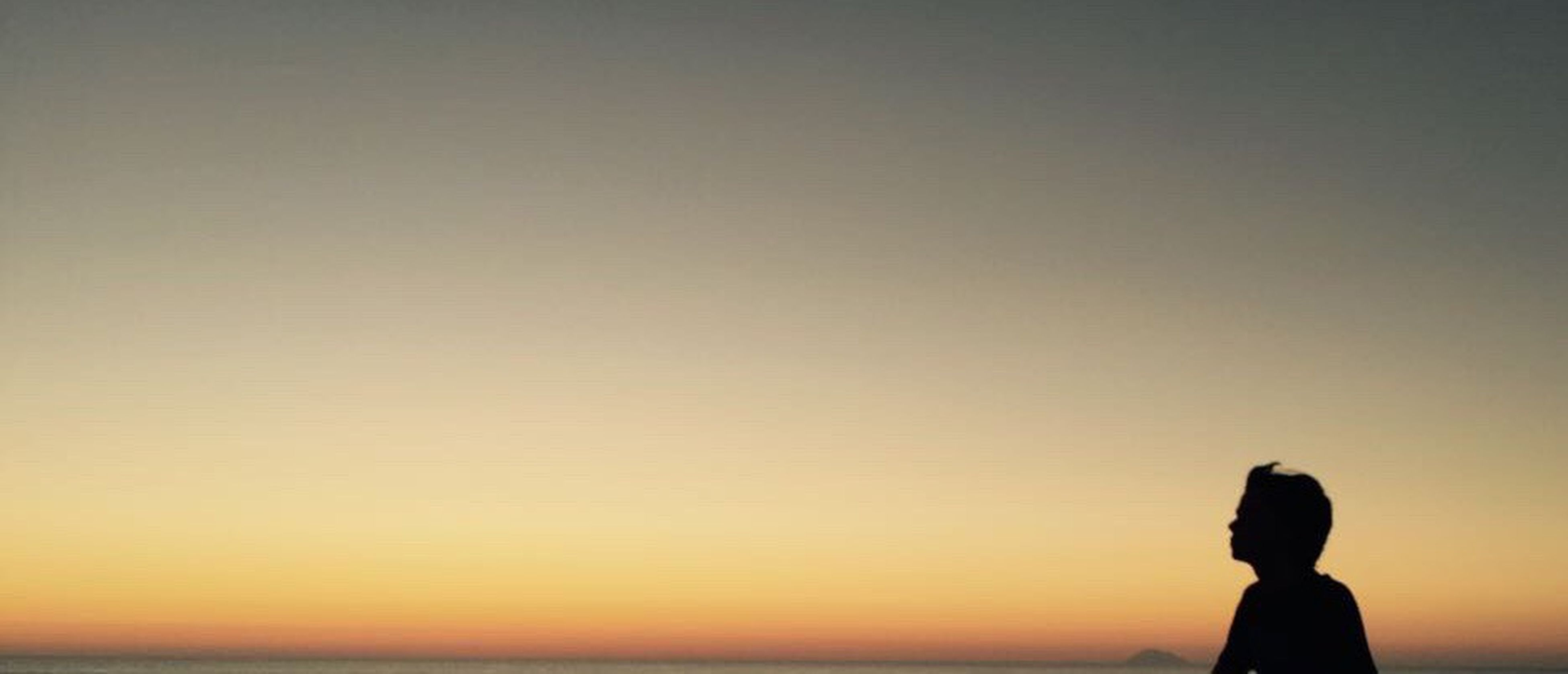silhouette, sunset, copy space, one person, tranquil scene, sky, beauty in nature, clear sky, childhood, outdoors, only women, women, people, nature, one woman only, females, child, adult, sea, horizon over water, one young woman only, young adult, day