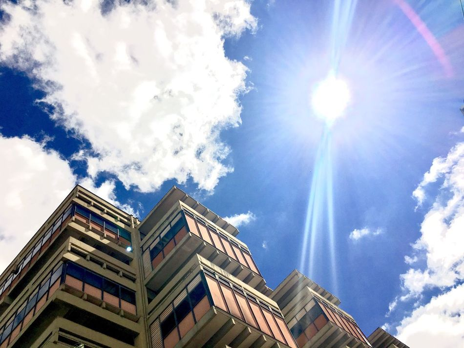Low Angle View Sky Building Exterior Architecture Built Structure Sunlight Sunbeam Lens Flare Cloud - Sky Day Outdoors No People Sun Best Photos Exceptional Photography EyeEm Best Shots Popular Photos First Eyeem Photo