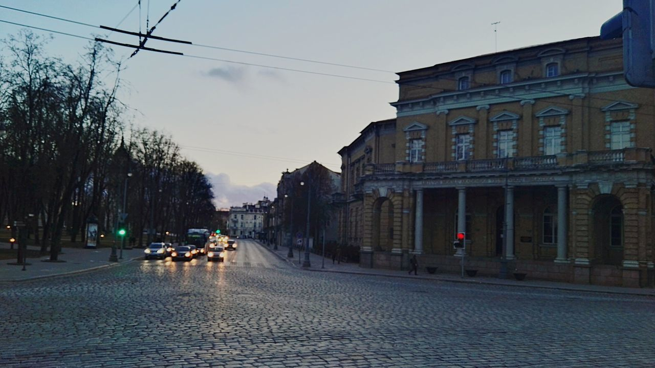 Outdoors Sky People Architecture Day Evening Street Cityscape Urban Skyline Building Exterior Architecture Outdoor Lithuania Old Town Built Structure City Cold Temperature Outdoor Photography Vilnius Town City Life Traffic Traffic Lights