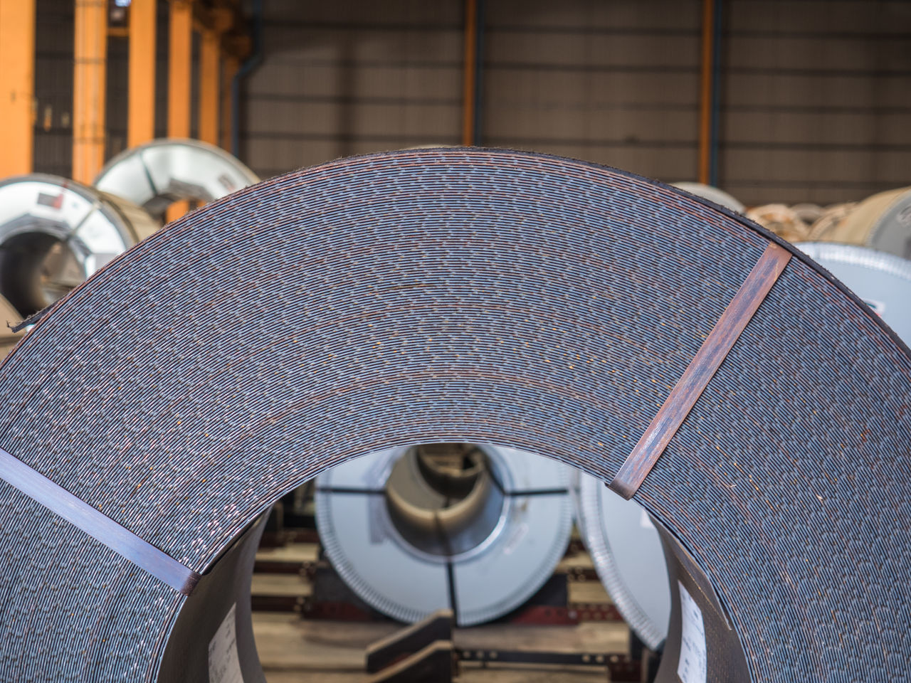 close up rolls of steel sheet Indoors  Technology Close-up No People coil steel Industry Indoors  Safety Shipping  Warehouse Storage stack Roll hot roll coil Transportation Handling Zinc Heavy Metal Heavy Plate Structure Iron sheet Shape Rod logistics Material rusty Automotive auto