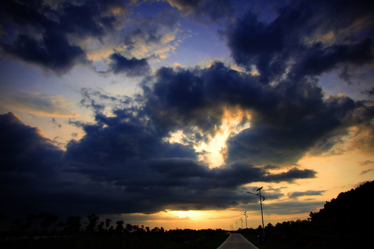 Sky Cloud - Sky Sunset Silhouette Dramatic Sky Scenics Beauty In Nature Nature No People Low Angle View Tranquil Scene Tree Outdoors Tranquility Storm Cloud Day