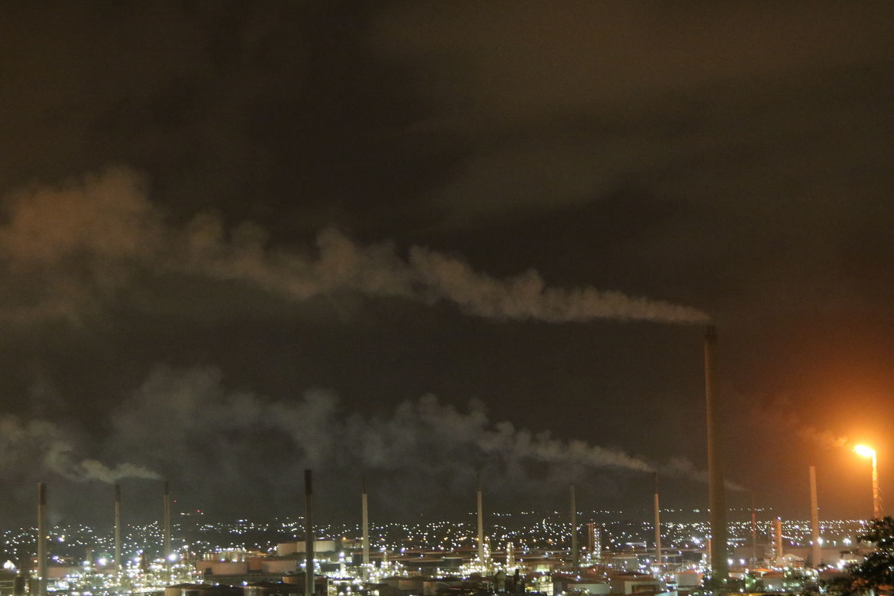 Air Pollution Building Exterior Built Structure Chimney Emitting Environmental Issues Factory Fumes Global Warming Illuminated Industry Night No People Outdoors Pollution Refinery Sky Smoke - Physical Structure Smoke Stack
