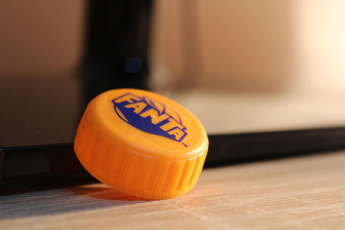 Fanta Yellow Close-up Indoors  No People Table Home Interior Low Light Photography Macro Photography Focus On Foreground Miniature Cap Bevrage Soda Drink Canonphotography HD Plastic One Object Orange Color Indoors  Texture Macro Single Object Wood - Material