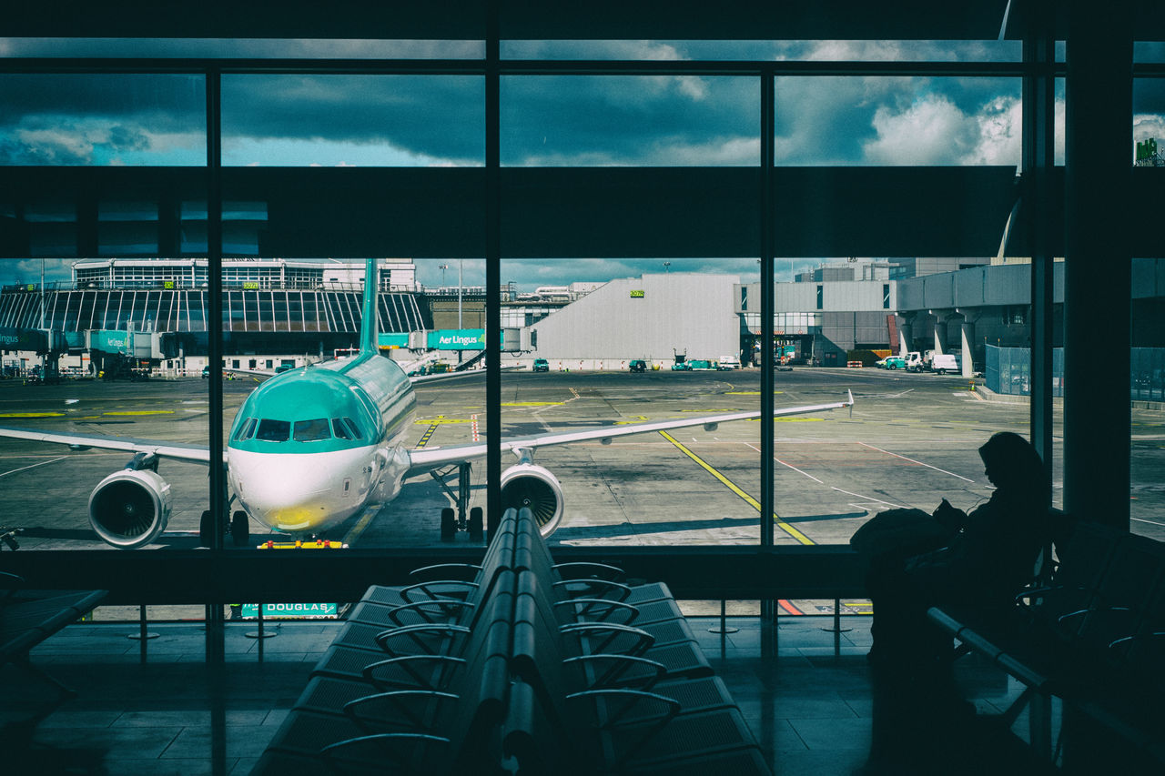 Aer Lingus Airport Blue Check-in Cloud Day Glass Journey Killing Time Sky Smartphone Transportation Traveling Waiting Woman