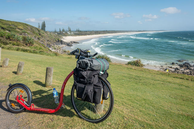 Kickbike with cargo on headland above surfing beach Beach Bicycle Day Getting Away From It All Grass Kickbike Leisure Activity Mode Of Transport Outdoors Riding San Sky Transportation Waves Weekend Activities