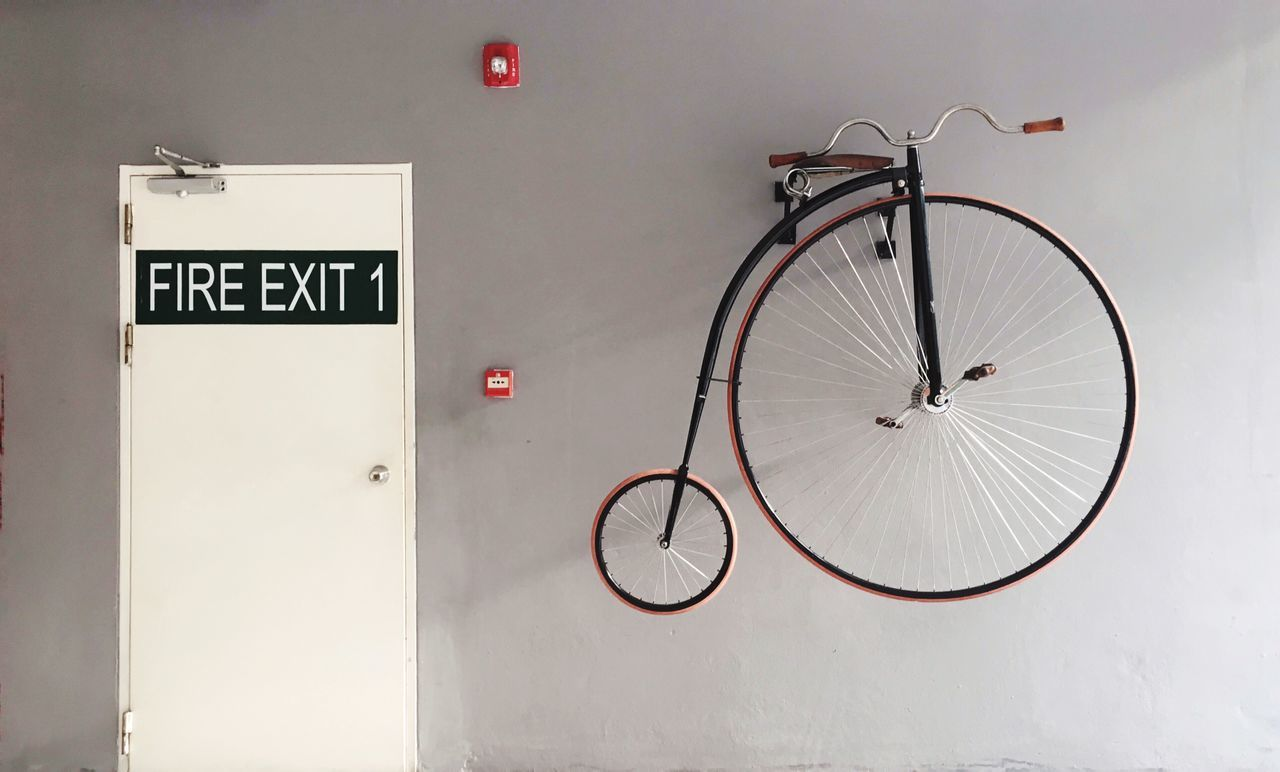 Bicycle Transportation No People Mode Of Transport Communication Day Indoors  Wall Building Exterior Architecture Decoration Door Doorway Fire Exit  Vintage Vintage Bicycles Decor Bike Close-up