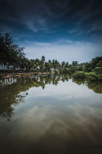 Beauty In Nature Calm Clouds And Sky Getty Images Gettyimages Idyllic Landscapes With WhiteWall Non-urban Scene Outdoors Reflections In The Water River View Scenics Seascapes Serene Outdoors Showcase July Standing Water Tranquil Scene Tranquility Tree Water
