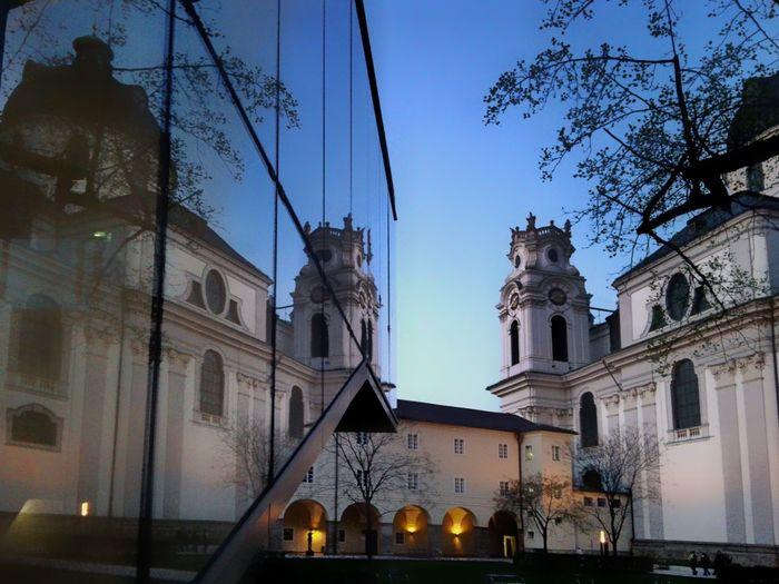 Architecture No People City Travel Destinations Kollegienkirche Salzburg Austria Reflection Spiegelung Uni Salzburg Furtwänglerpark Blue Sky Blue Hour Trees And Sky Universitätskirche Universitätsbibliothek Hofstallgasse Perspective