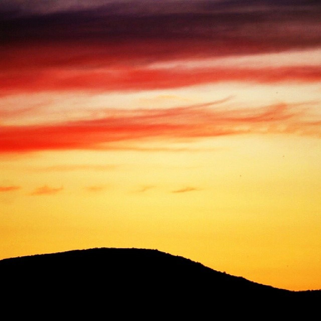 sunset, silhouette, scenics, beauty in nature, orange color, nature, sky, tranquility, no people, tranquil scene, cloud - sky, outdoors, backgrounds, yellow, day