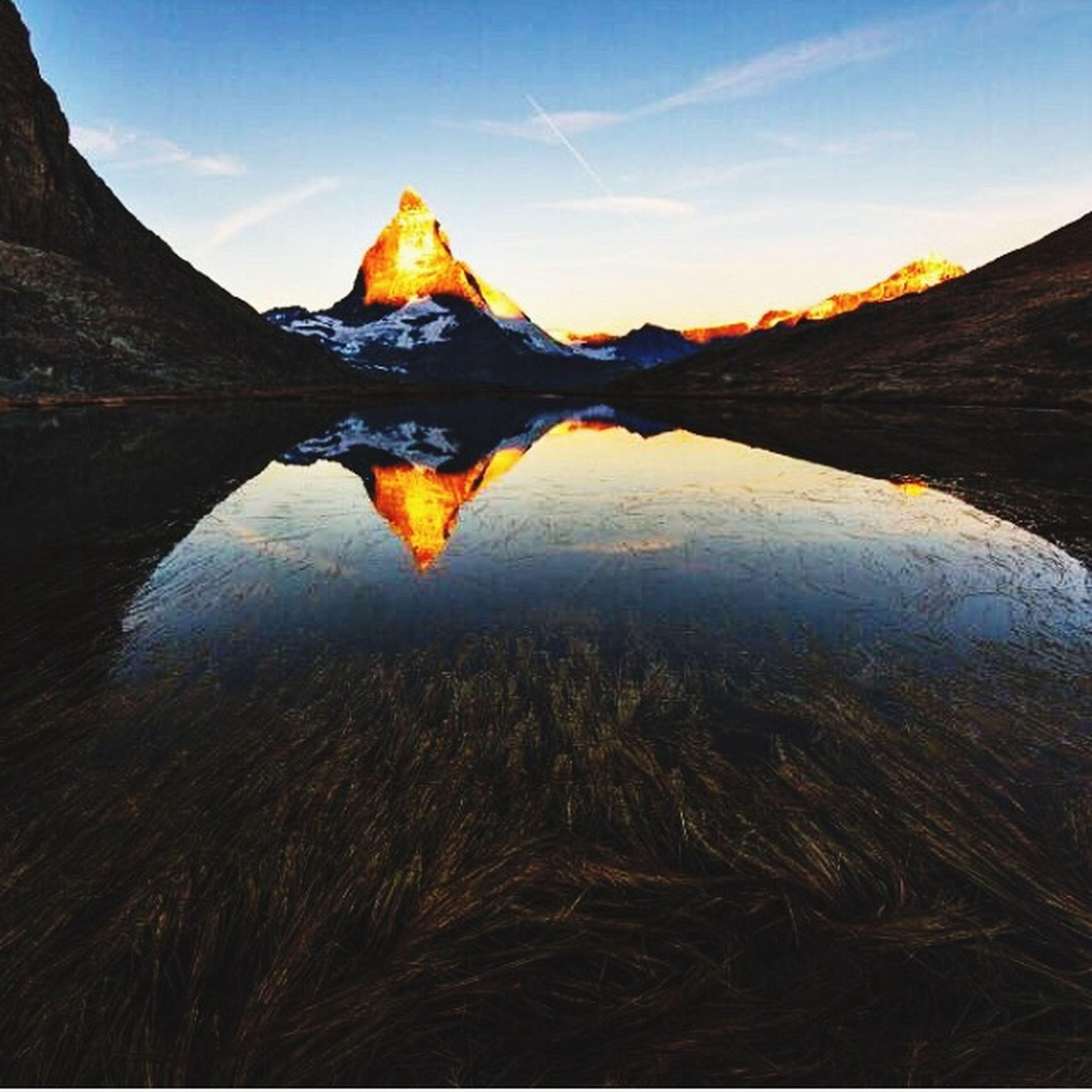 water, mountain, tranquility, lake, tranquil scene, beauty in nature, reflection, sky, scenics, nature, season, yellow, autumn, landscape, mountain range, idyllic, non-urban scene, outdoors, day, close-up
