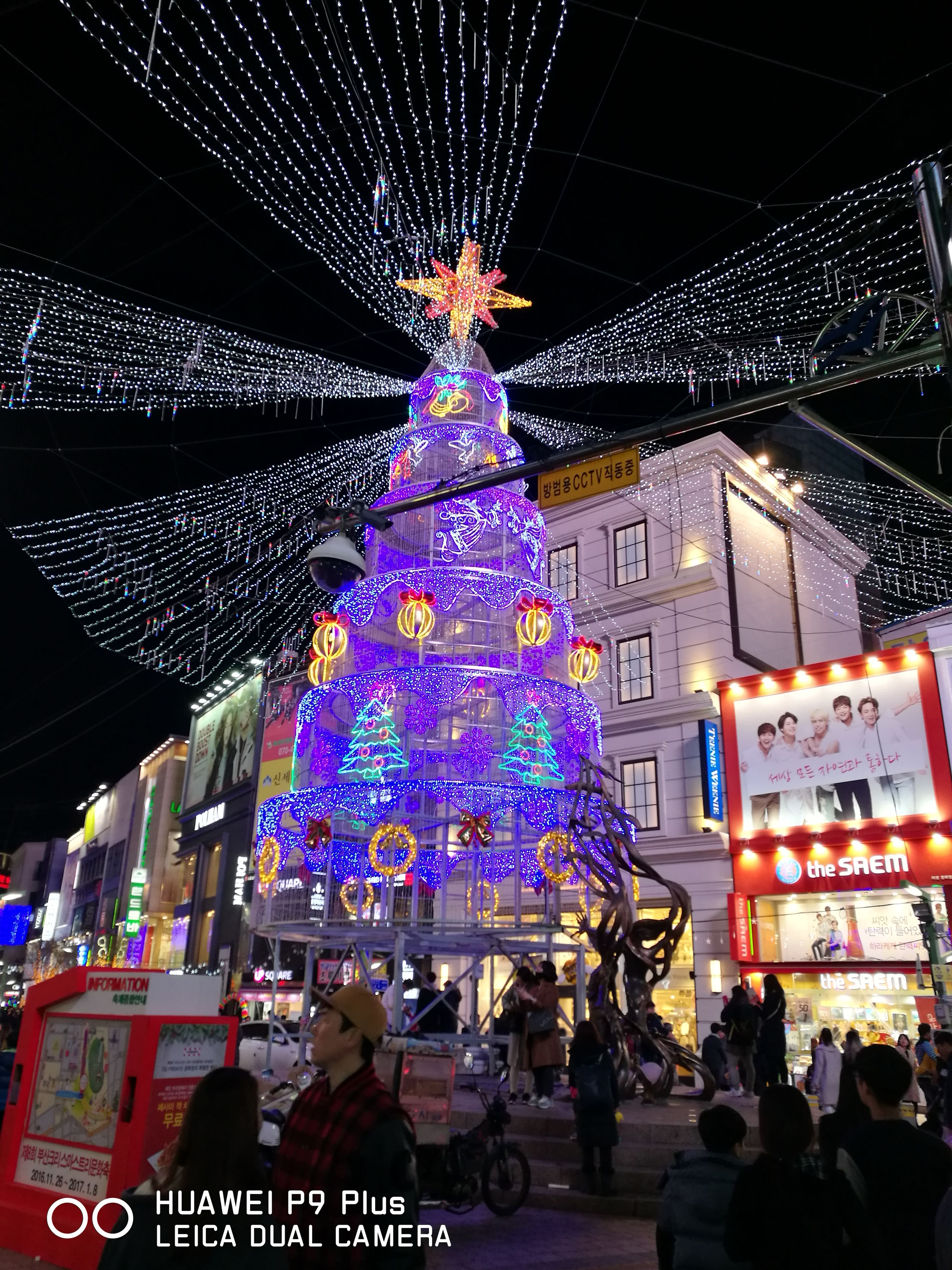 night, christmas lights, illuminated, built structure, christmas decoration, celebration, architecture, christmas, lighting equipment, multi colored, travel destinations, large group of people, christmas tree, sky, christmas ornament, outdoors, crowd, people