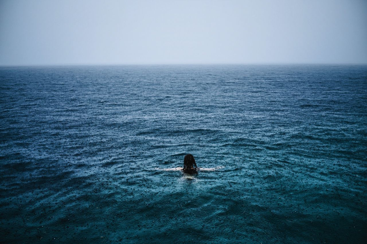 Free in her wilderness Girl Swimming Sea Ocean Blue Rain Raining Woman Magic Mysterious Foggy INDONESIA Sulawesi Bunaken Showcase July Color Palette Eyeemphoto