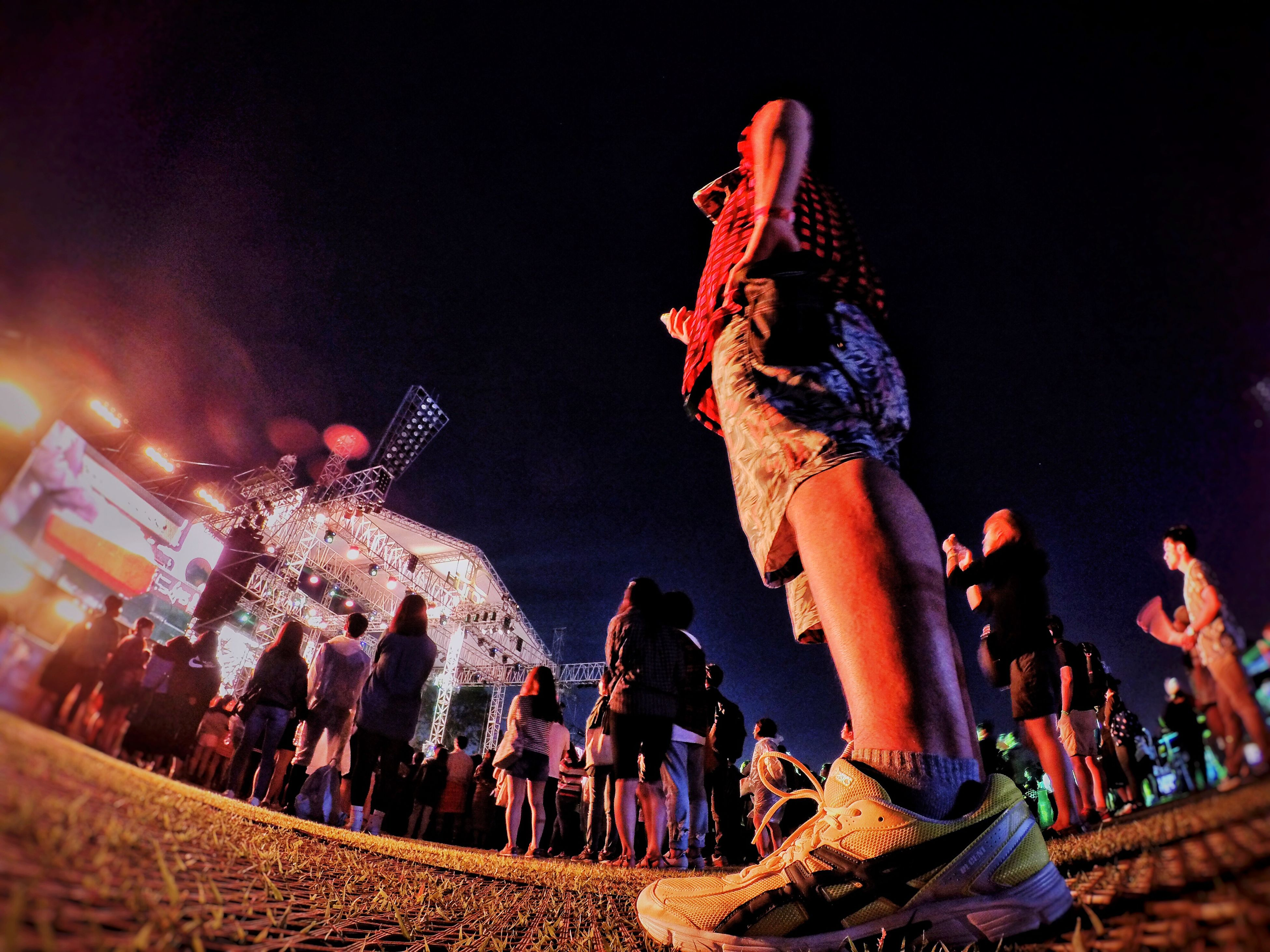 night, lifestyles, arts culture and entertainment, leisure activity, illuminated, men, large group of people, person, event, celebration, crowd, enjoyment, performance, music, fun, excitement, cultures, tradition, dancing