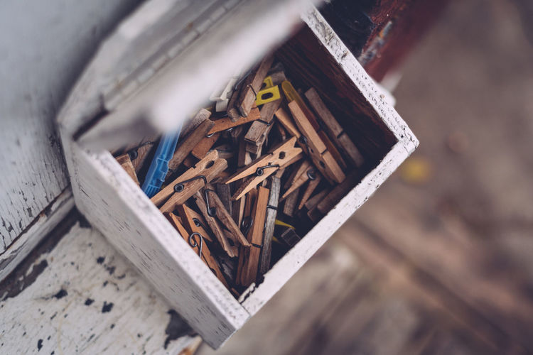 Backyard Chipped Wood Clothespins High Angle View House Exterior Looking Down Open Box Selective Focus
