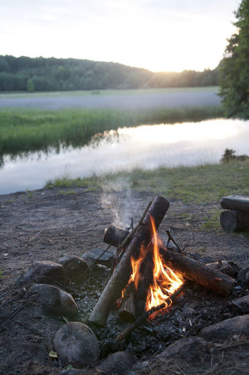 burning campfire Blaze Campfire Poland Twilight Beauty In Nature Burning Burnt Dawn Day Fire Fireplace Firewood Flame Glowing Lake Landscape Log Fire Nature No People Outdoors Scenics Sky Tranquil Scene Tranquility Water