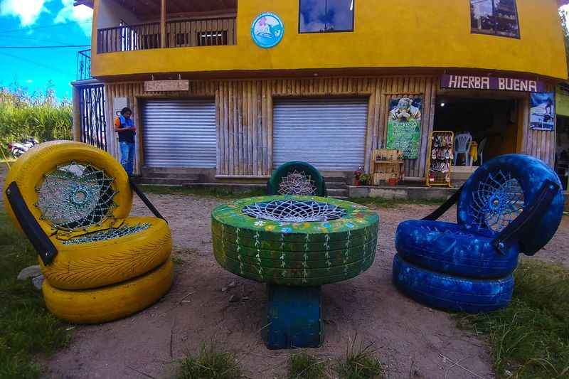 Outdoors Multi Colored Day Tires Chairs Table Painted Tires Original Building Store Tea Store Doors Wood Yellow Colors Summer