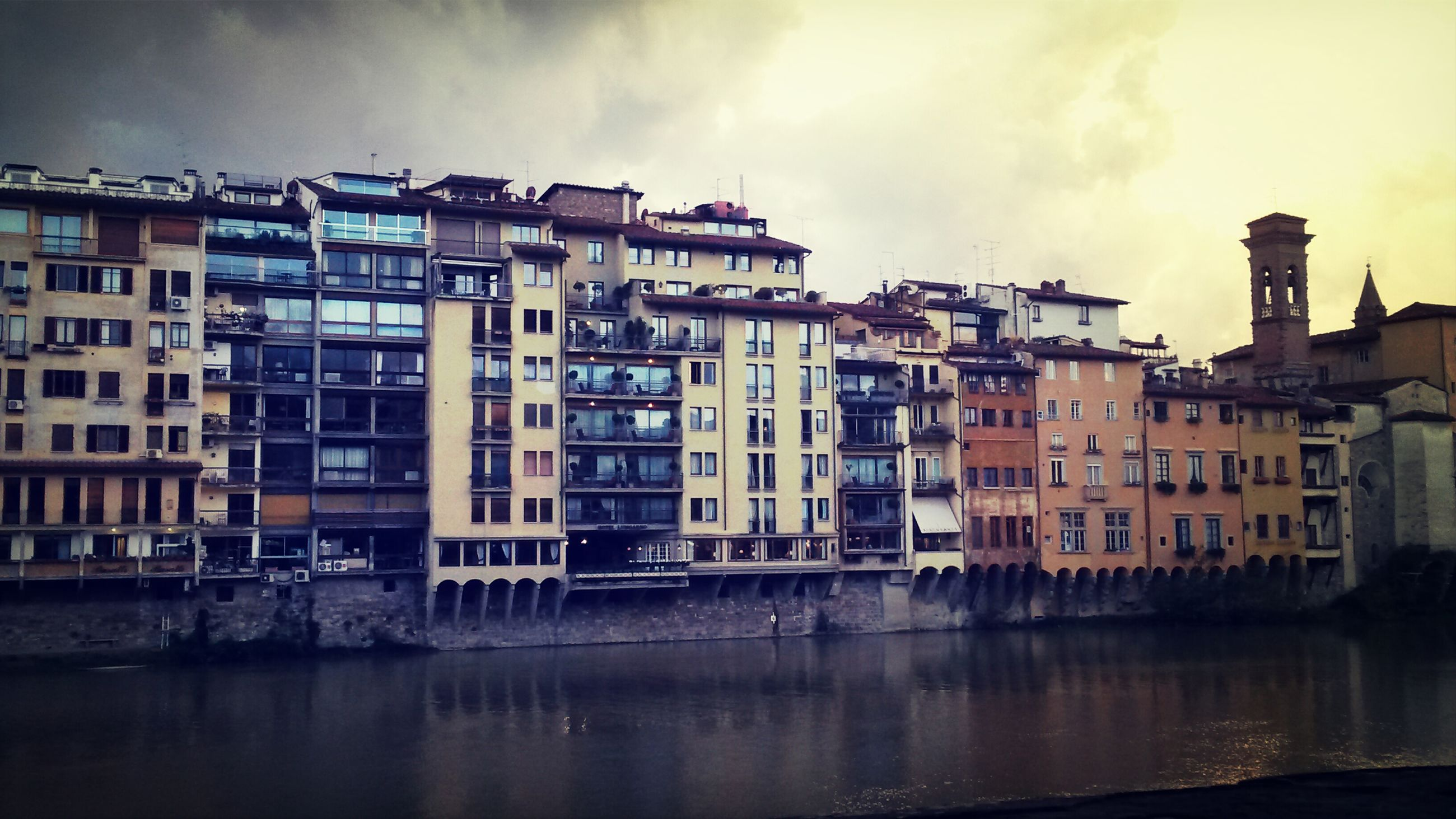 architecture, building exterior, built structure, water, sky, waterfront, cloud - sky, city, reflection, building, residential structure, residential building, cloudy, river, residential district, cloud, overcast, outdoors, house, no people