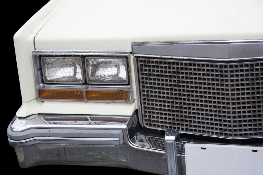 Part of vintage Cadillac Eldorado Biarritz - American Luxury Car, Model Year 1976 1976 American Cadillac Cadillac Eldorado Cadillac Eldorado Biarritz Car Classic Car Close-up Collector's Car Front View General Motors  Gm  Land Vehicle Luxury Luxurylifestyle  No People Nostalgia Outdoors Run-down Sedan Transportation USA Vintage Vintage Cars White