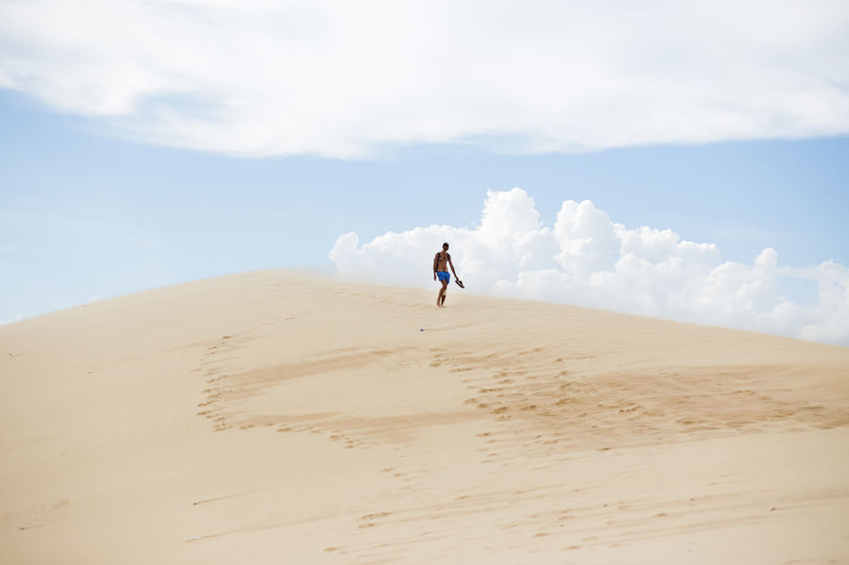 White Sand Dunes, Mui Ne, located in the south of Vietnam. It's about 5-hour away from Ho Chi Minh City. Arid Climate Beach Beauty In Nature Cloud - Sky Desert Full Length Landscape Leisure Activity Lifestyles Muine Muine, Vietnam  Nature Outdoors Sand Sand Dune Scenics Sky Tranquil Scene Tranquility Unrecognizable Person Vacations White Sand Dunes Break The Mold TCPM Art Is Everywhere