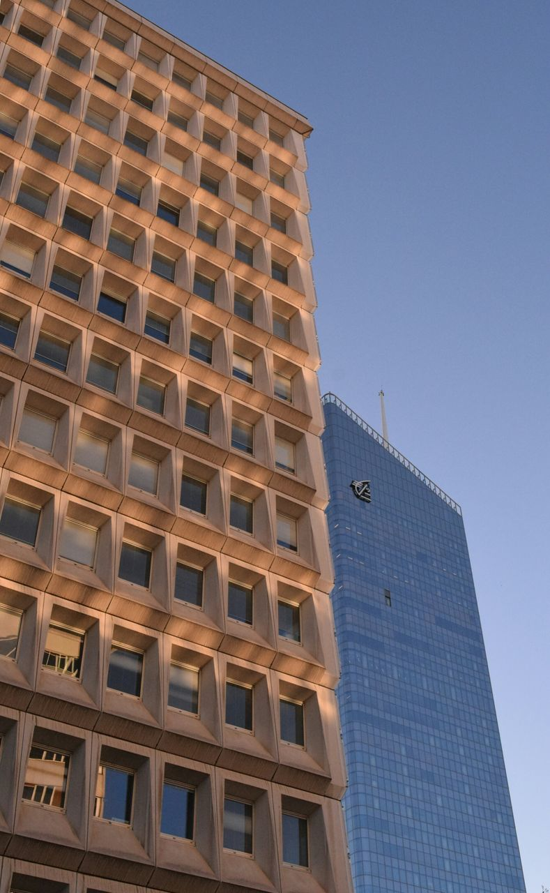 architecture, building exterior, built structure, modern, low angle view, skyscraper, city, tower, clear sky, outdoors, day, tall, no people, sky