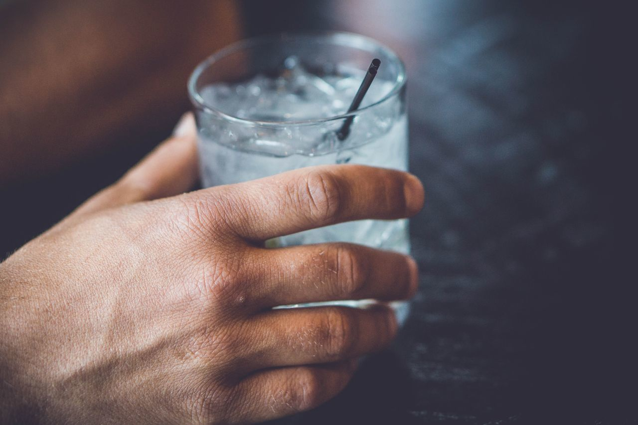 EyeEm Selects Drinking Glass Drink Refreshment Holding Alcohol Human Hand Human Body Part One Person Indoors  Close-up Shot Glass Cold Temperature People Adult Adults Only Day Only Men