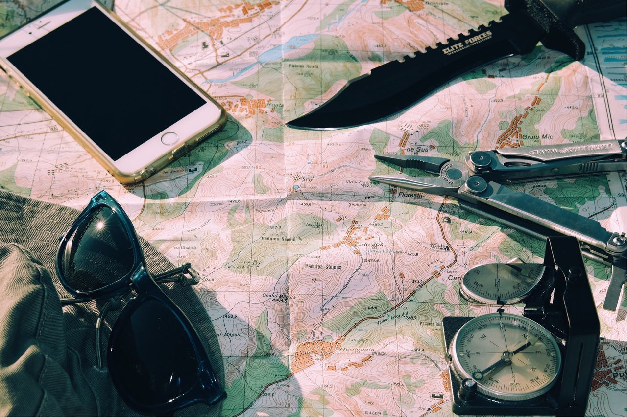 Travel items... Navigational Compass Map Weapon Details Of My Life Leisure Activity Fresh On Eyeem  My Favorite Photo Adventure Travel Survival Knife VSCO Made In Romania Sunny Day Outdoors Adventure Navigation Route Hike Close Up Items Explore View From Above Tools Letherman