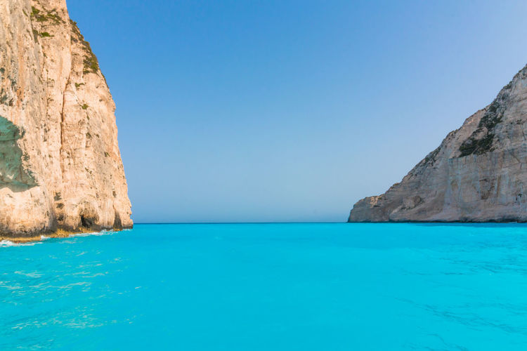 Navagio Beach with shipwreck in Zakynthos, Greece Amazing Bay Beach Beauty In Nature Blue Blue Sky Day Greece Ionian Sea Ionianislands Island Nature Nature Navagio Beach NavagioShipwreck Outdoors Scenics Sea Summer Tranquility Travel Turquoise Colored Water Water Reflections Zakynthos