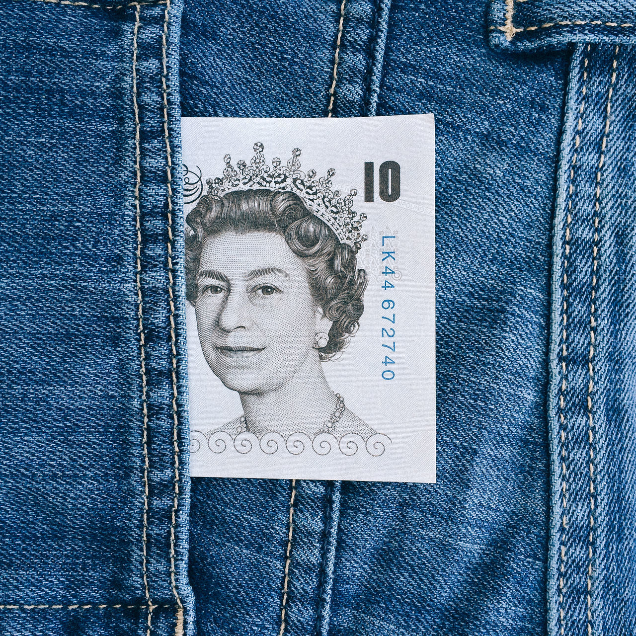 British 10 pound note protruding from pocket of blue denim jeans 10 10 Pound Note British Cash Currency Denim Jeans Legal Tender Material Money Note Pocket  Pocket Money Pounds Protruding Queen Queen Elizabeth  Queens Head Symbol Ten Pound Note Uk