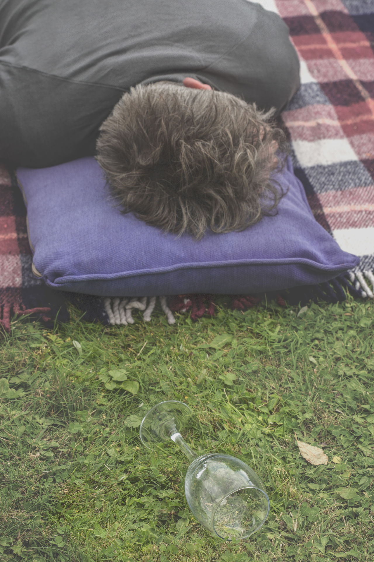Man lying down in garden sleeping with fallen empty wine glass in grass Alcohol Alcoholism Asleep Close-up Drunk Elderly, Empty Flat Out Grass Grassy Grey Haired Lying Down Lying On The Grass Male Man Outdoors Relaxation Resting Sleeping Summer Unconcious Wine Wine Glass