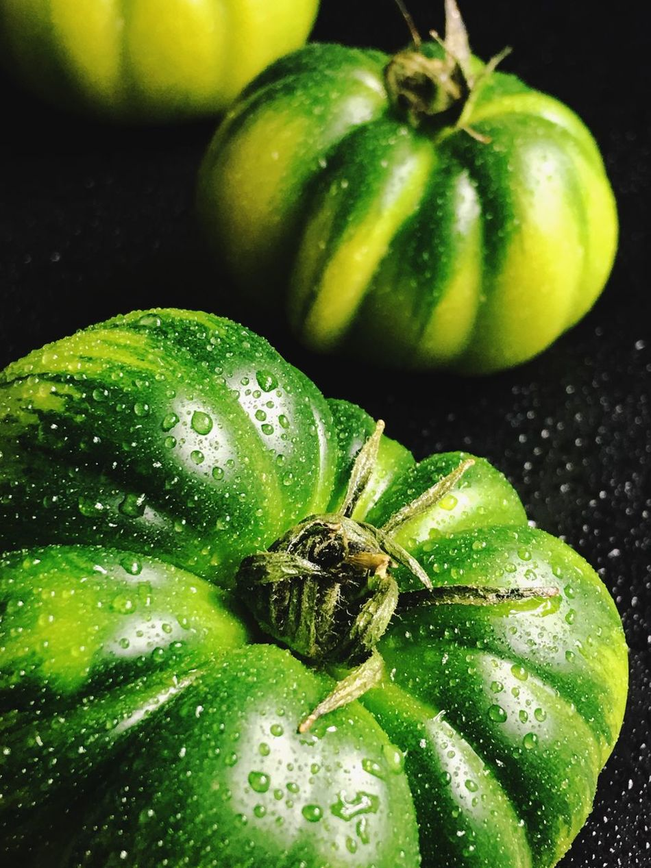 Macro shot of green tomatoes Green Color Close-up Fruit No People Food And Drink Healthy Eating Food Freshness Tomato Nature Indoors  Day Macro Vertical Photography Color Image Studio Shot Focus On Foreground Water Wet