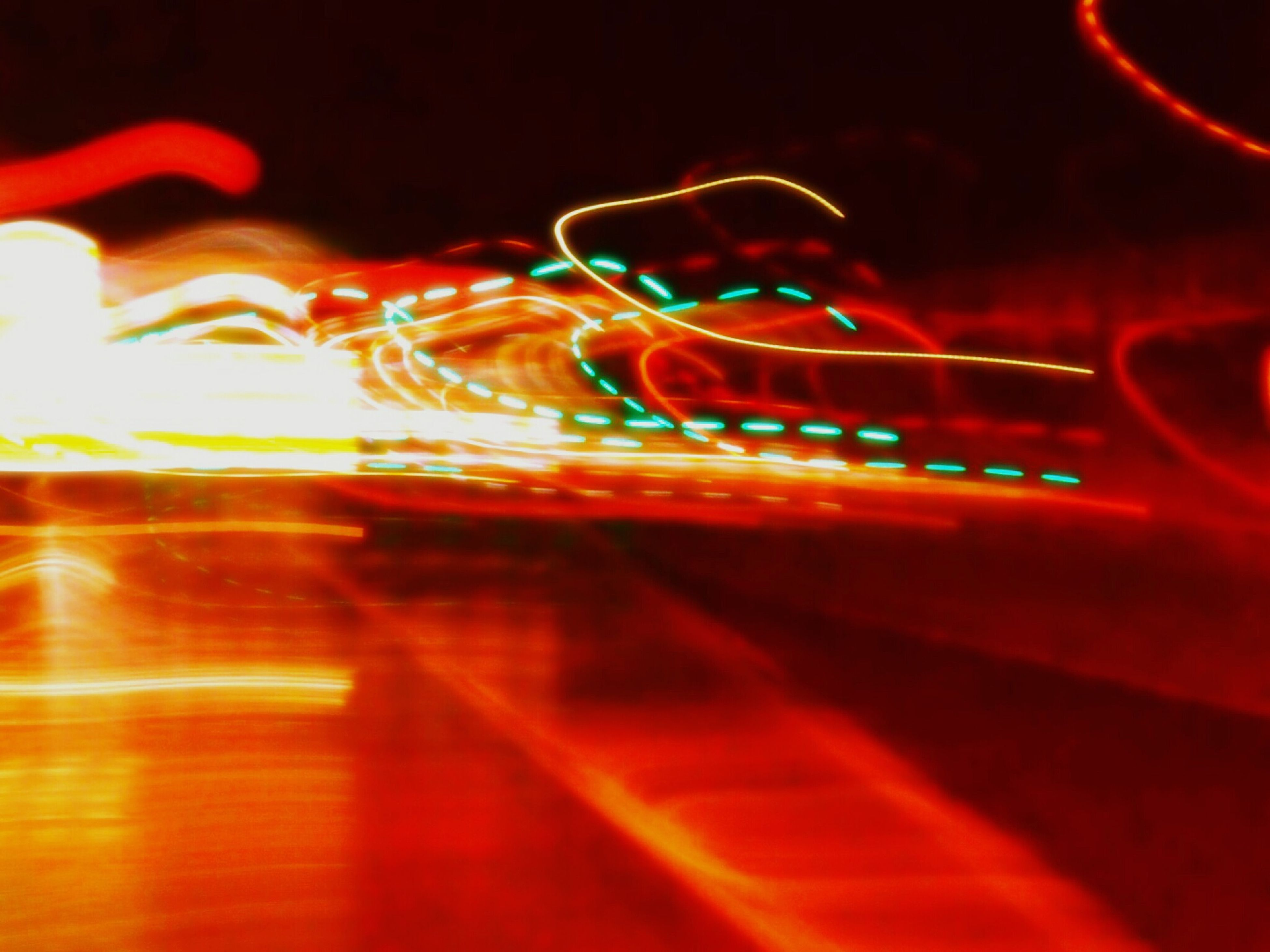illuminated, night, motion, red, blurred motion, long exposure, speed, multi colored, light - natural phenomenon, light trail, glowing, arts culture and entertainment, abstract, lens flare, close-up, street, defocused, pink color, reflection, outdoors