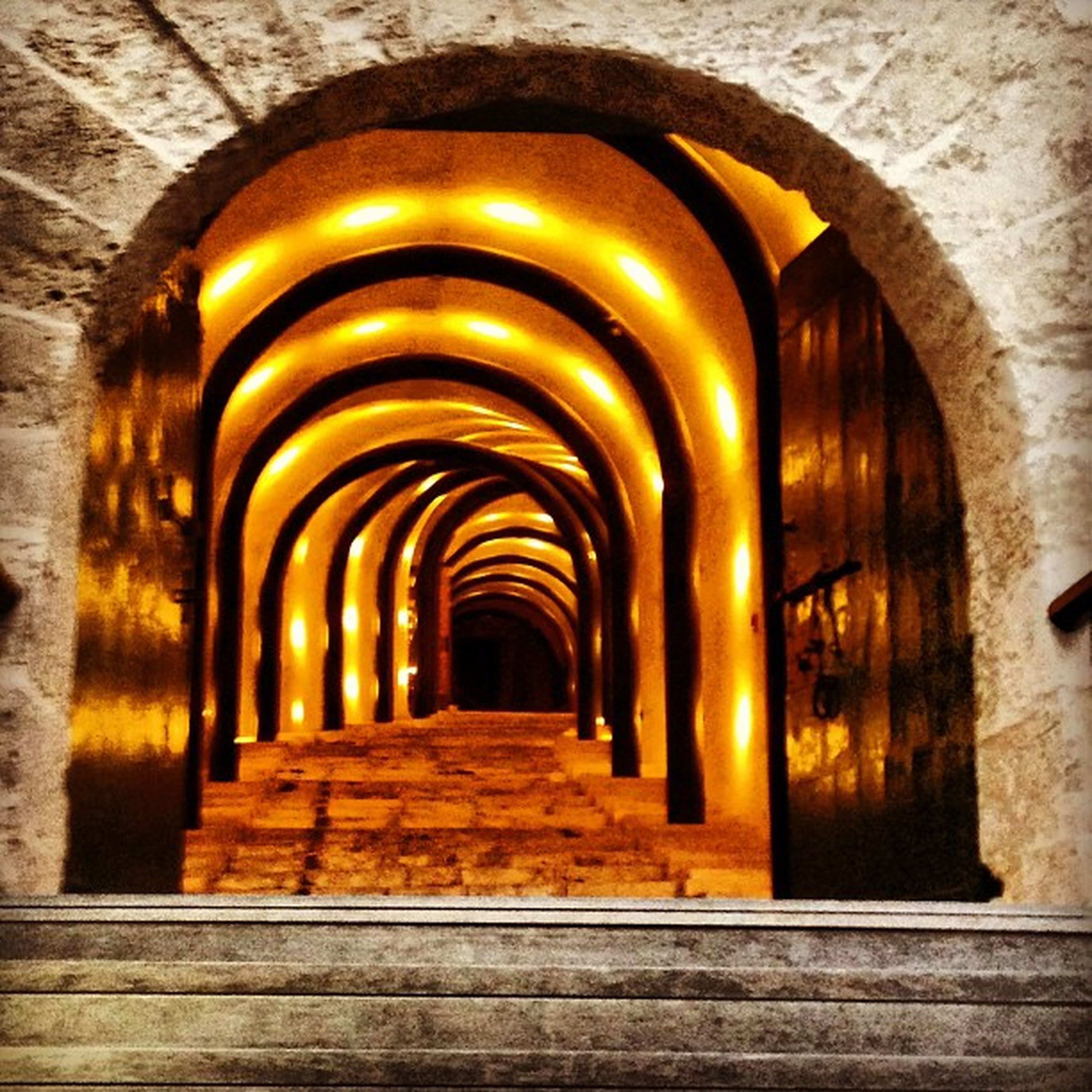 arch, indoors, the way forward, architecture, built structure, diminishing perspective, archway, corridor, vanishing point, in a row, architectural column, history, tunnel, colonnade, ceiling, arched, old, illuminated, empty, interior