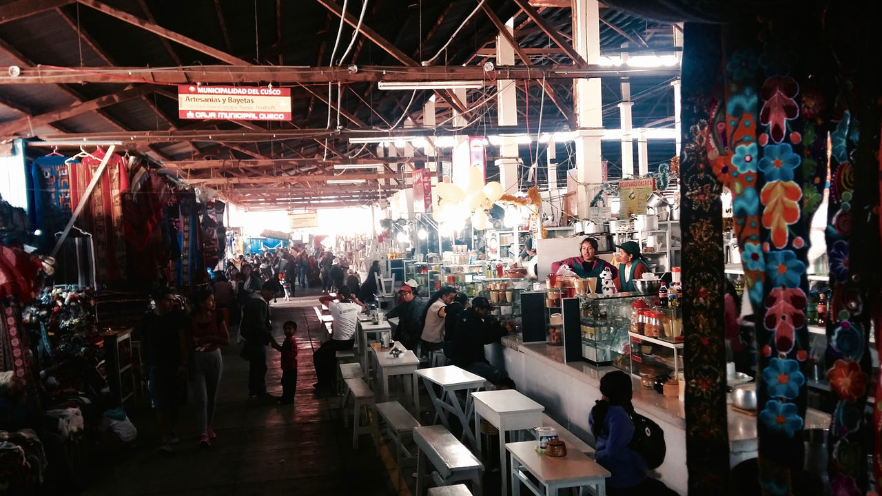 Food Stalls at Cusco Market Commerce Food Stall Indoors  Market People Restaurant Retail  Roof Seating Bench Structure