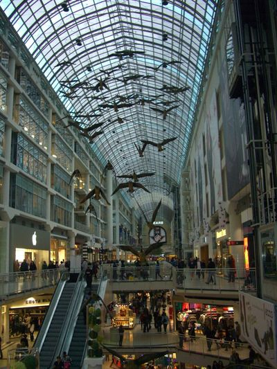 Eaton Centre Shopping Mall Architectural Feature Architecture Birds Built Structure Can Capital Cities  City Life Composition Crowd Daylight Full Frame Glass Roof Illuminated Incidental People Indoor Photography Interior Leisure Activity Lifestyles Modern Retail  Shopping Mall Shops Toronto Tourism Tourist Destination