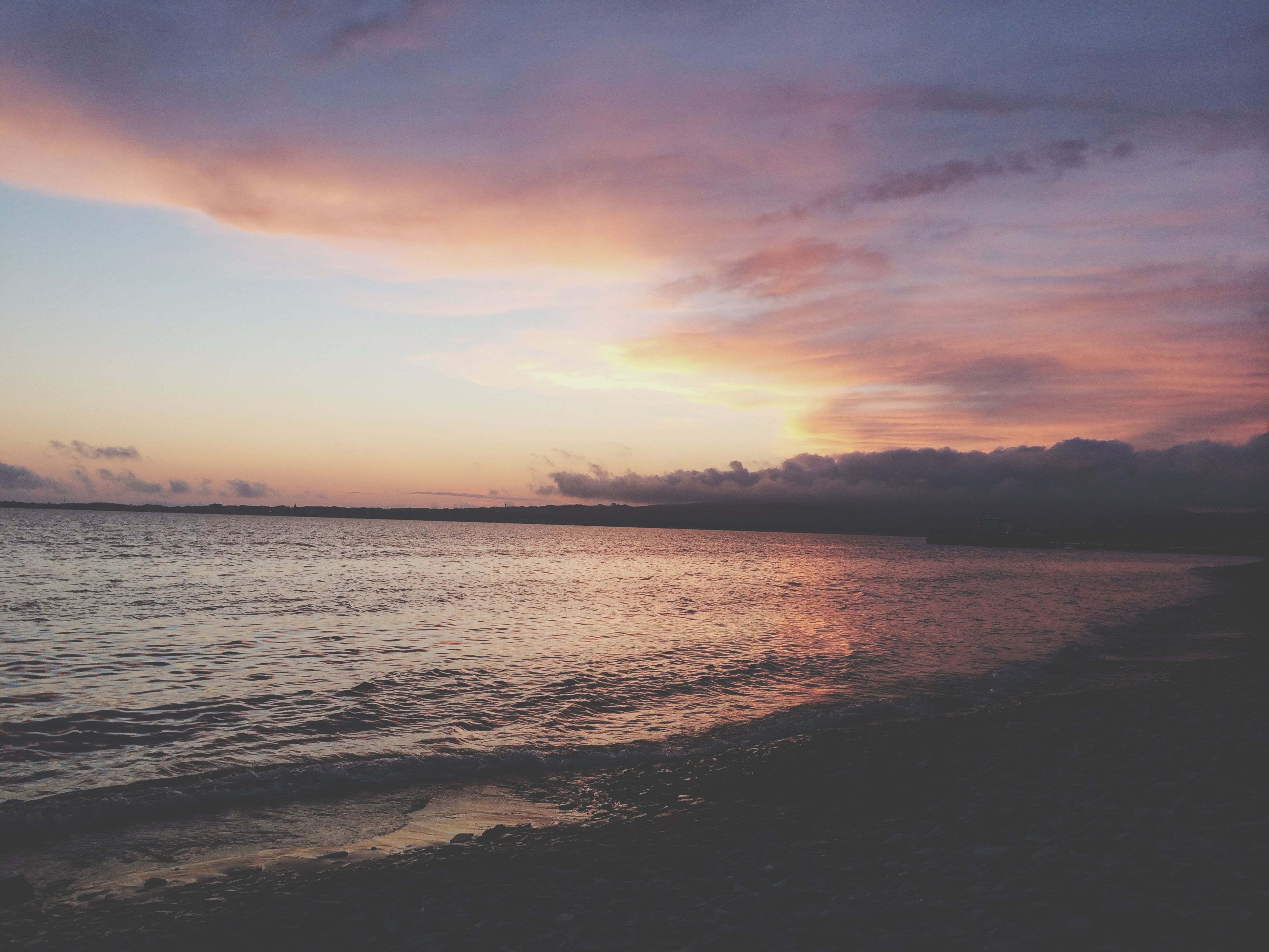 sunset, water, tranquil scene, scenics, tranquility, sky, beauty in nature, sea, cloud - sky, idyllic, orange color, nature, reflection, beach, lake, shore, cloud, silhouette, outdoors, non-urban scene