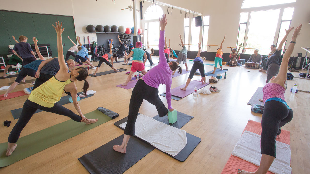 Outdoors Yoga Practice Adult Adults Only Balance Candid Day Exercising Full Length Guidance Gym Health Club Healthy Lifestyle Indoors  Lifestyles Men People Real People Self Improvement Senior Women Sports Clothing Studio Togetherness Wellbeing Women Yoga