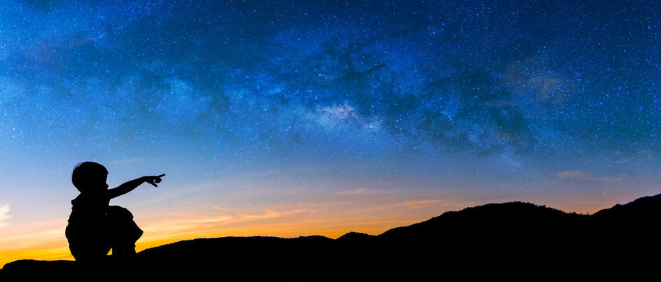 Astronomy Beauty In Nature Boy Boys Fingers Galaxy Galaxy Leisure Activity Lifestyles Men Milky Way Nature Night One Person Outdoors People Point Real People Scenics Silhouette Sit Sky Standing Star - Space Sunset