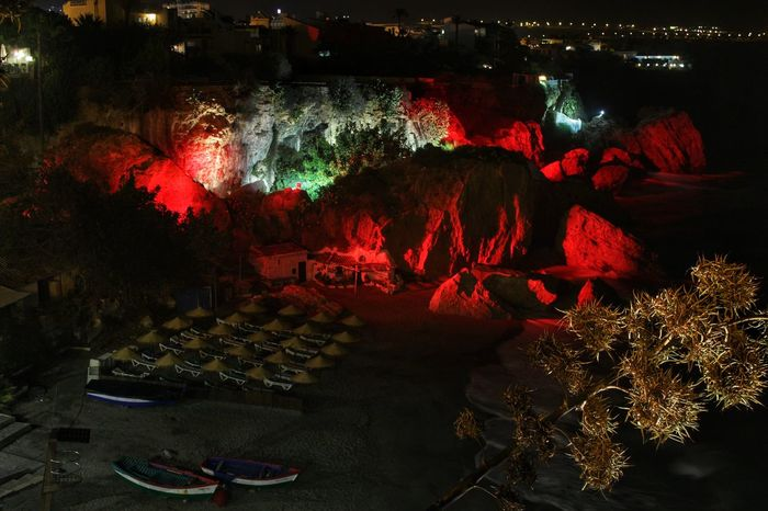 Nighttime illuminations on the coast at Nerja, Spain Coast At Nerja Dark Glowing High Angle View Illuminated Illuminated Rocks Illumination Illuminations Landscapes With WhiteWall Multi Colored Nerja Nerja Andalucia Nerja Coast Nerja Coast At Night Nerja Illuminated Rocks Night Nighttime Illuminations Orange Color Outdoors Red Red Rocks  Rocks Lit Red