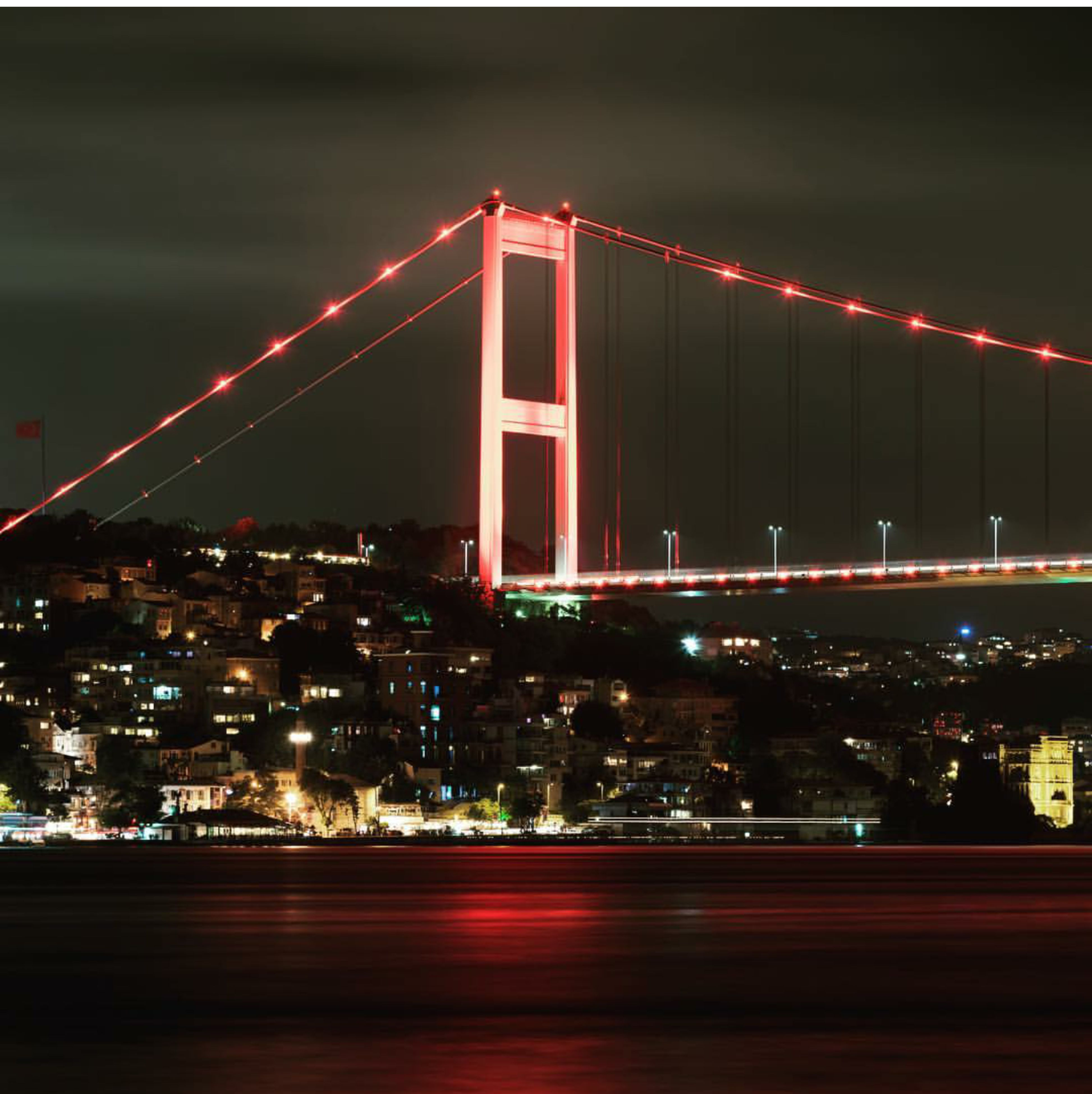built structure, architecture, illuminated, suspension bridge, bridge - man made structure, tourism, travel destinations, travel, connection, night, famous place, city, international landmark, transportation, engineering, building exterior, golden gate bridge, sky, city life, cloud - sky, outdoors, wide, building story, capital cities, wide shot, residential district, san francisco bay